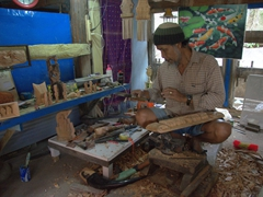 Friendly wood carver; Huta Siallagan