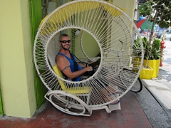Robby in a wicker rickshaw