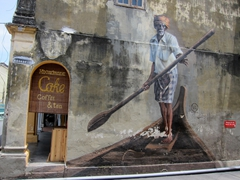 Old man paddling a boat wall mural