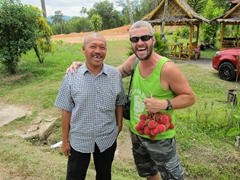 Robby with our friendly driver after buying some rambutans