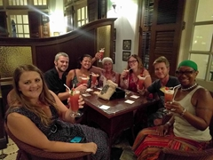Our group enjoying a round of Singapore Slings at the Long Bar; Raffles Hotel