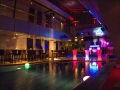 SkyBar pool lit up at night
