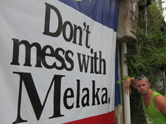 "Robby strikes his best ""Don't mess with Melaka"" pose"