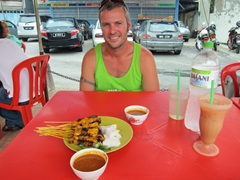 Robby about to dig into our chicken and beef satay meal at Restoran Line Clear in Kampung Jawa, a local favorite for tender/chunky satay