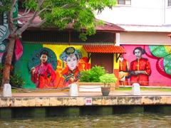 Colorful wall murals by the Malacca riverfront