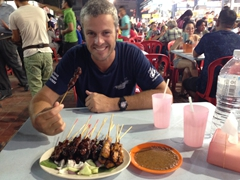 Robby getting ready to chow down on our satay dish (pork, lamb and beef) - super tasty and cheap at Jalan Alor night market