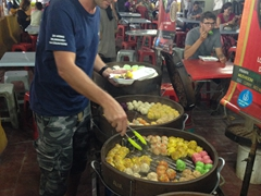 Robby selecting dim sum at Jalan Alor night market