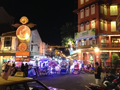 Glowing rickshaws at the end of Jonker Street