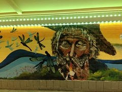 Interesting wall murals decorate an underground tunnel in Singapore