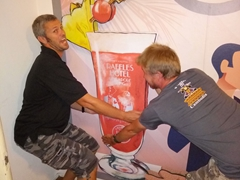 Robby and Lars attempting to steal the Singapore Sling cardboard cutout!