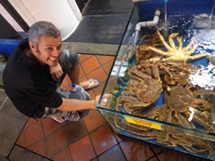 Robby posing next to massive Australian king crabs