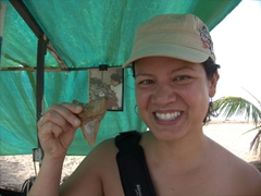 Becky strikes a pose next to a massive fossilized shark's tooth; Puntarenas
