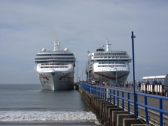 It's a Norwegian cruise day (Norwegian Pearl on the left and Norwegian Sun on the right); Puntarenas Port