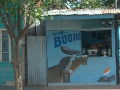 A man with his sewing machine is open for business; Puntarenas