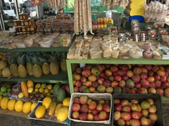 Fresh fruits and snacks for sale (with free samples) by the roadside