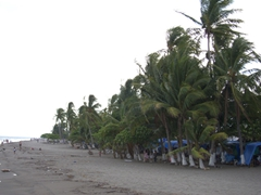 As dusk approaches, the Puntarenas black sand beach becomes deserted