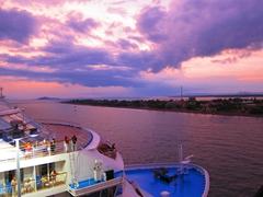 Sunset overlooking the bow of Norwegian Sun; Puntarenas