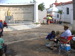 A shoe polisher conducts brisk business in Tapachula