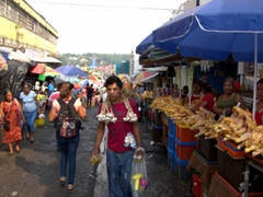 A shopper drapes garlic around his neck once his hands get full; Tapachula Market