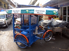 A tricycle cart is a popular mode of transportation to carry goods home from the market; Tapachula