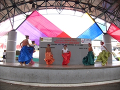 Girls in colorful skirts performing a traditional dance; Tapachula Dance Festival