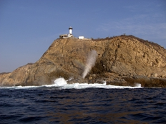 Lighthouse and blowhole at Huatulco