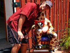 Robby shares a read with a giraffe