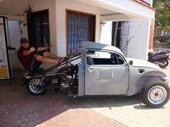 Robby checks out a modified motorcycle - Volkswagon Bug