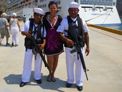 Becky strikes a pose with two friendly members of the Mexican coast guard