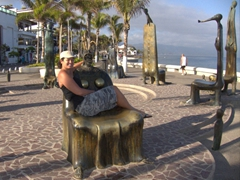 Becky poses on an intersting chair statue; Puerto Vallarta malecon