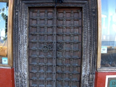 An ornate wooden door leads to a leather shop; Puerto Vallarta