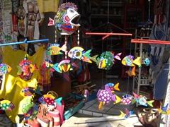 Vibrant fish decorations for sale at Puerto Vallarta's flea market