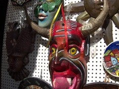 Lots of masks for sale at the Cuale River Island craft market