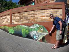 Robby and a massive iguana; outside Puerto Vallarta's municipal market (flea market)