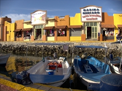 Boats at dock in front of the Marina arts and craft market; Cabo San Lucas