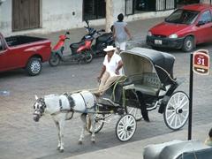 Horse carriages abound around Izamal Square