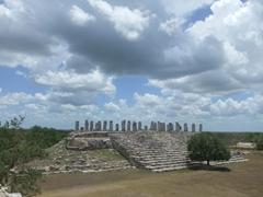 Massive stone pillars at Ake's Maya ruin