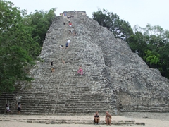 Tourists climbing up Nohoch Mul (giant pyramid) of Coba