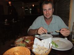 Robby enjoying the salsa/nacho dip of Carboncitos, Playa del Carmen