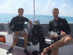 Hector (from Scuba Playa) and Robby smile in between dives; Playa del Carmen