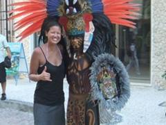 "Becky posing next to a colorfully clad ""Mayan warrior""; Playa del Carmen"