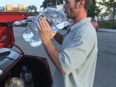 Robby gulping down a 5 gallon jug of water; Playa
