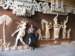 Becky assumes a pose next to a Mayan relief; Playa del Carmen