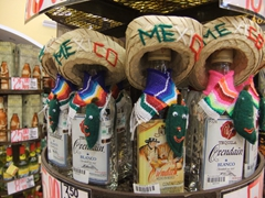 Mexican sombreros atop tequila bottles, only in Playa del Carmen!