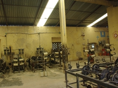 Interior view of a functioning henequen factory, Ake