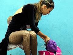 A tango dancer prepares for her street performance; Caminito