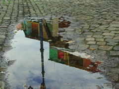 Puddle reflection of colorful Caminito; Buenos Aires