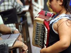 Girl playing an accordion; San Telmo flea market