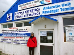 """Becky stands in front of the """"Oficina Antartica"""", which touts itself as Antarctica's most active gateway"""