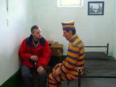 Robby chatting up a prisoner at Ushuaia's prison/maritime museum